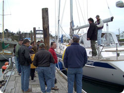 A Rig Your Boat Workshop class examining a boat on the water